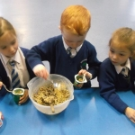 pupils making bird food